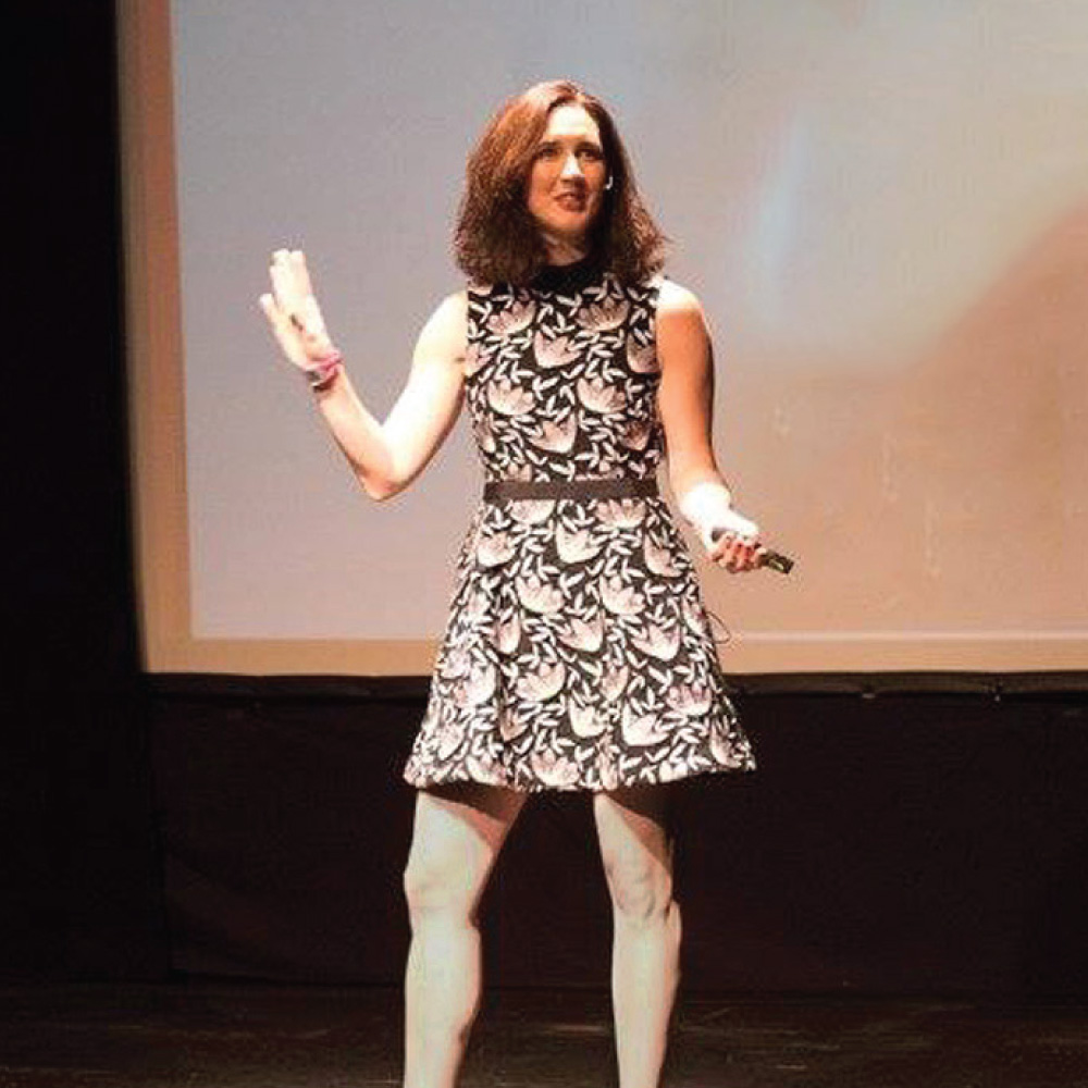 book alexandra, alexandra solomon on stage at a speaking event