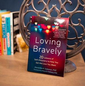 loving bravely bibliotherapy blog post image, picture of book on a table